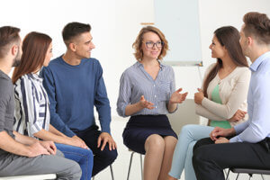 Therapist leading group session for psychiatric disorders